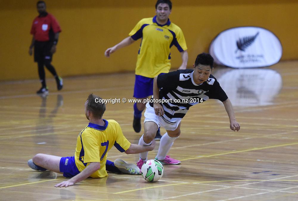 Southern's MIchael Sannum trips up Jiong Zhang. Futsal South v Northern Futsal. National Futsal League, Series 3. ASB Stadium, Auckland, New Zealand. Friday 5 December 2014. Photo: Andrew Cornaga/photosport.co.nz