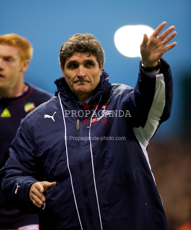 STOKE, ENGLAND - Sunday, October 19, 2008: Tottenham Hotspur's manager Juande Ramos waves good-bye to the supporters following his side's 2-1 defeat to Stoke City during the Premiership match at the Britannia Stadium. (Photo by David Rawcliffe/Propaganda)