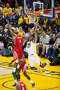 Golden State Warriors forward Kevon Looney (5) defends Houston Rockets forward PJ Tucker (4) during Game 6 of the Western Conference Finals at Oracle Arena in Oakland, Calif., on May 26, 2018. (Stan Olszewski/Special to S.F. Examiner)