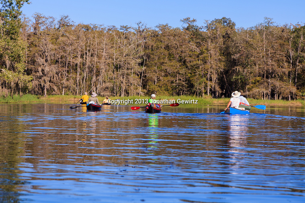 Canoeists enjoying scenic Fisheating Creek in the Fisheating Creek WMA, Florida. WATERMARKS WILL NOT APPEAR ON PRINTS OR LICENSED IMAGES.