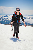 Portrait of a young woman climber as she makes her way up the Muir snow field on Mount Rainier, Washington State, USA.