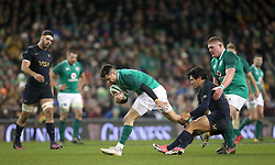 Ireland's Conor Murray is pulled back by Argentina's Matias Moroni during the Autumn International at the Aviva Stadium, Dublin.