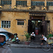 A street scene in Hoi An, Vietnam. Hoi An is an ancient town and an exceptionally well-preserved example of a South-East Asian trading port dating from the 15th century. Hoi An is now a major tourist attraction because of its history. Hoi An, Vietnam. 5th March 2012. Photo Tim Clayton