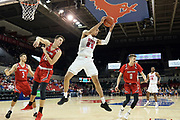 SMU Mustangs forward Ethan Chargois (25) brings down a rebound against Hartford Hawks forward Miroslav Stafl (12) while Hunter Marks (0), Romain Boxus (3) and Isiaha Mike (15) await the pass during an NCAA college basketball game, Wednesday, Nov. 27, 2019, in Dallas.SMU defeated Hartford 90-58. (Wayne Gooden/Image of Sport)