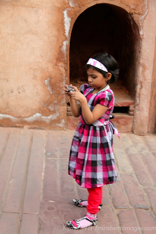 Asia, India, Agra. Girl with camera at the Red Fort of Agra, a UNESCO World Heritage Site.