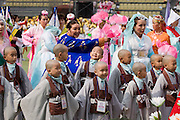 The annual Lotus Lantern Festival is held to celebrate Buddha's Birthday. Opening ceremony for the parade at Dongdaemun Stadium. Little monks.
