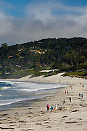 People walking dogs on white sand beach at Carmel Beach, Carmel, Monterey Peninsula, California