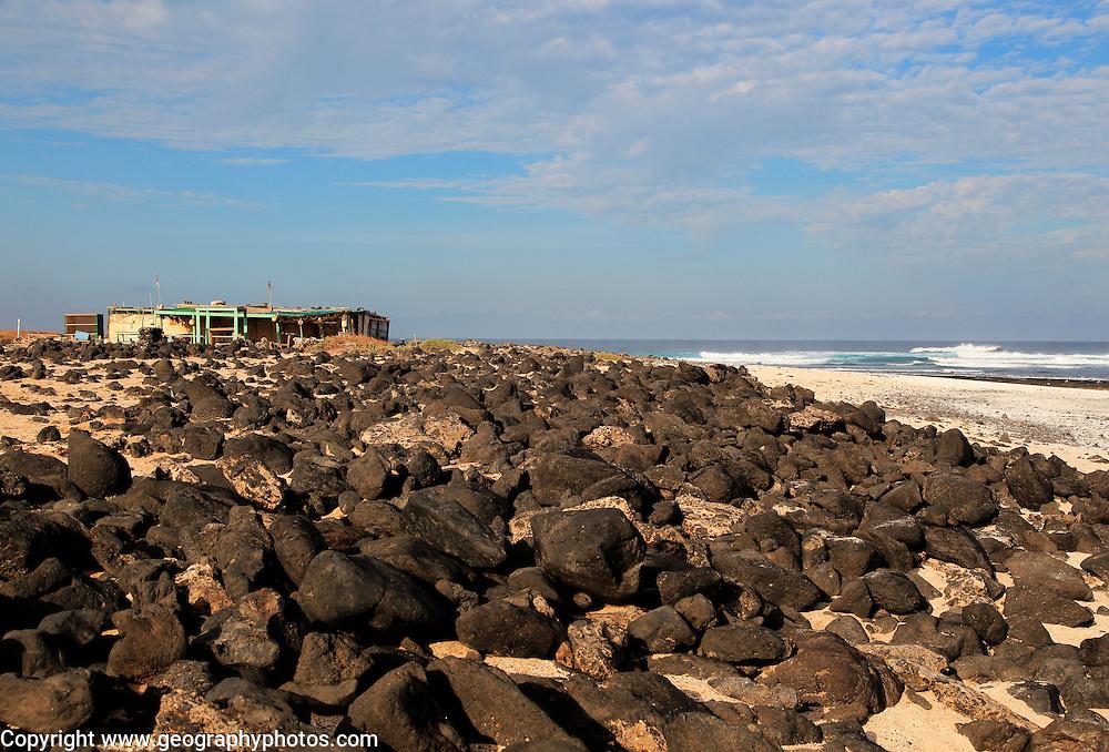 Beach fishing shack buildings near Majanicho on north coast of Fuerteventura, Canary Islands, Spain