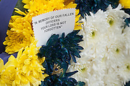 Goshen, New York - A message on flowers at the Orange County Law Enforcement Officer Memorial Service on May 2, 2014. The memorial service honors the memory of the 27 members of the Orange County law enforcement community that died in the line of duty. The service also pays tribute the families and loved ones left behind for their courage, dignity and perseverance.