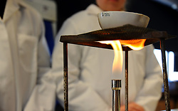 A science experiment takes place in a classroom.