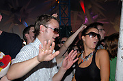 Couple with sunglasses dancing inside a tent, Metro Weekender, Get Loaded In The Park, London 2006