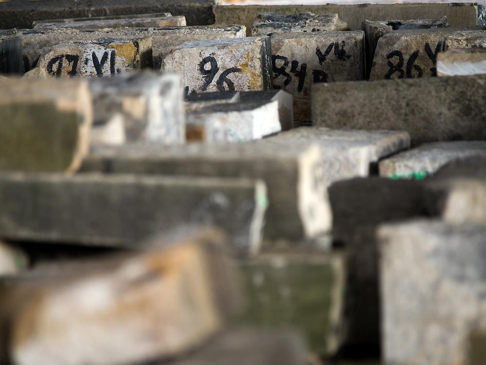 Lager fuer Steinbloecke der Prager Karlsbruecke welche wegen ihrem schlechten Zustand waehrend der Sanierung gegen neue ausgetauscht werden muessen. Das Lager befindet sich im Prager Stadtteil Kobylisy - die erste Phase der Sanierung wird bis zum Jahr 2010 dauern. Die Reparatur kostet voraussichtlich mehr als 222 Millionen Kronen kosten.<br /> <br /> Storage place for stones from Charles Bridge at the Prague quater Kobylisy - those stones had to be removed with new ones because of unrepairable damage. The Charles Bridge renovation will be completed in June 2010 and the repairs should prevent water leakage and improve the infrastructure of the bridge and its access roads. Repair works will cost more than 222 million crowns.