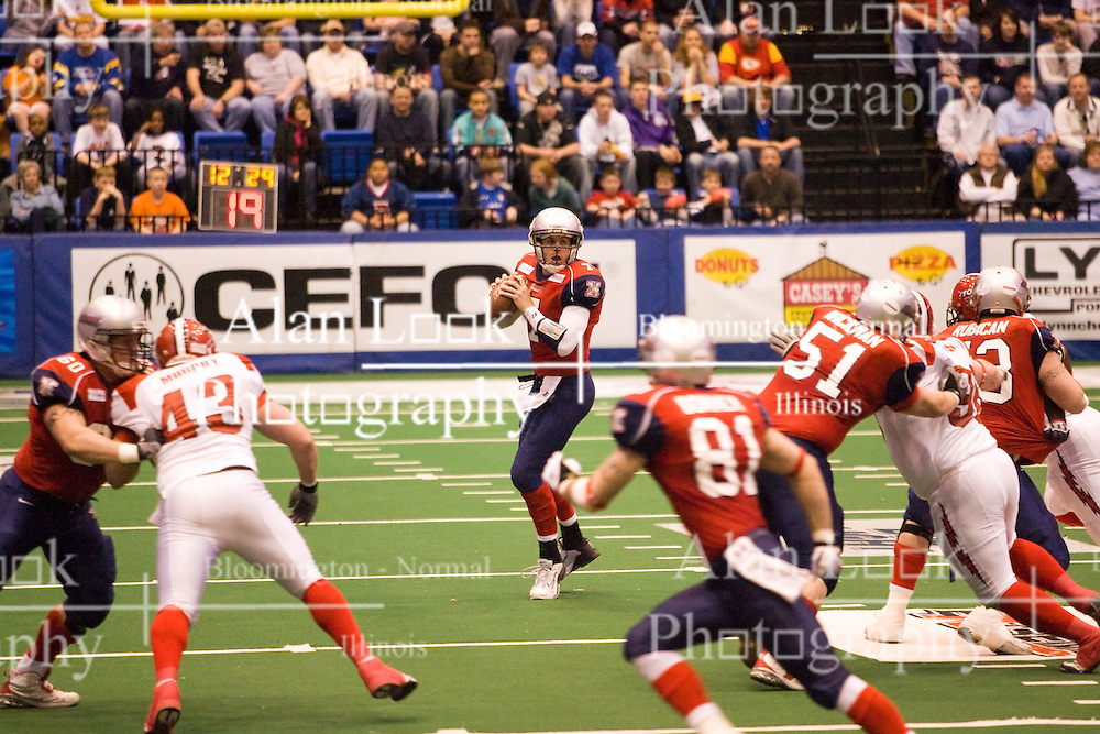 14 March 2009: Mitch Tanney receives good offensive blocking from his line as he drops to make a pass. The Sioux Falls Storm were hosted by the Bloomington Extreme in the US Cellular Coliseum in downtown Bloomington Illinois.