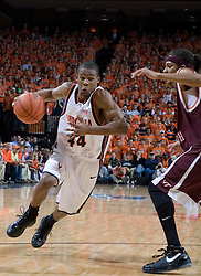 Virginia Cavaliers point guard Sean Singletary (44) dribbles around Virginia Tech Hokies forward Deron Washington (13).  The Virginia Cavaliers Men's Basketball Team defeated the Virginia Tech Hokies 69-56 at the John Paul Jones Arena in Charlottesville, VA on March 1, 2007.