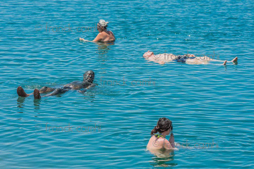 Dead Sea, Jordan - May 6, 2013 people swimming bathing in Dead Sea Jordan