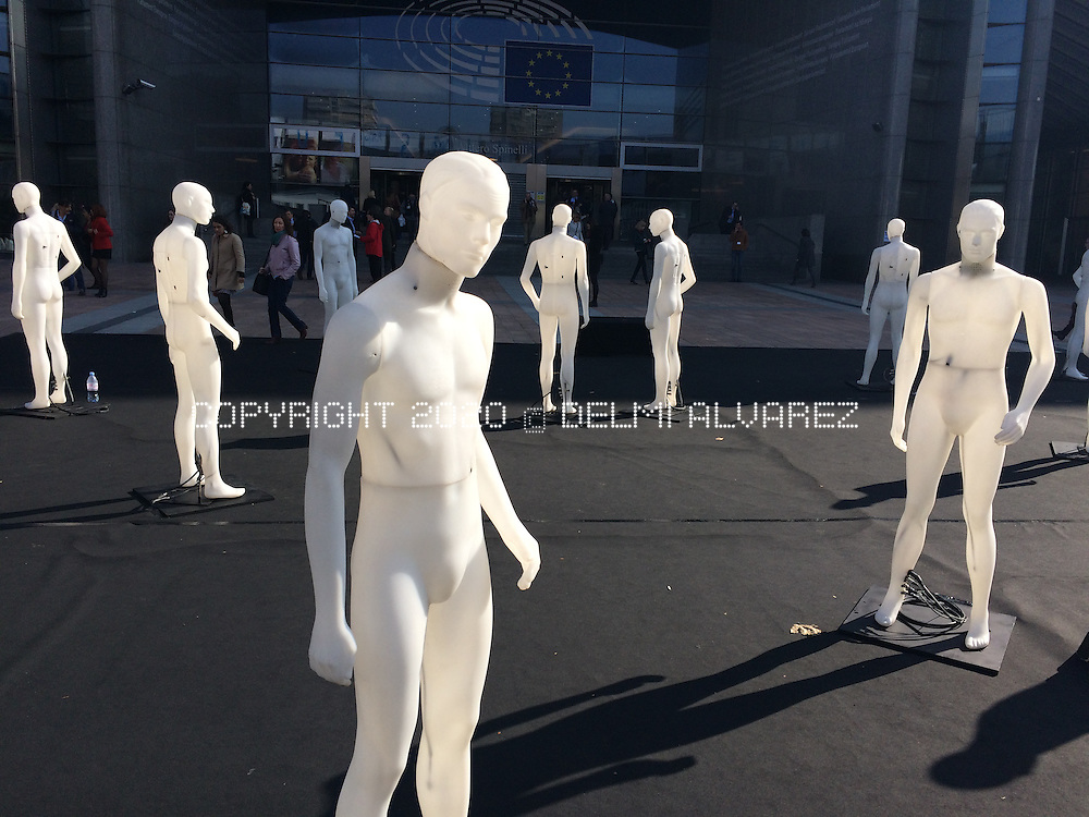 exhibition of standing men near EU parliament
