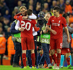 LIVERPOOL, ENGLAND - Thursday, March 10, 2016: Liverpool's manager Jürgen Klopp celebrates the 2-0 victory over Manchester United with Adam Lallana after the UEFA Europa League Round of 16 1st Leg match at Anfield. (Pic by David Rawcliffe/Propaganda)