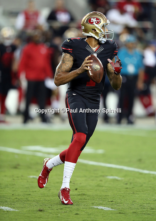 San Francisco 49ers quarterback Colin Kaepernick (7) scrambles while looking to pass during the 2015 NFL week 1 regular season football game against the Minnesota Vikings on Monday, Sept. 14, 2015 in Santa Clara, Calif. The 49ers won the game 20-3. (©Paul Anthony Spinelli)