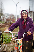 Portrait of 83 years old Didima - who is still riding her bike - during a visit at the local cemetary in Marginenii de Jos.
