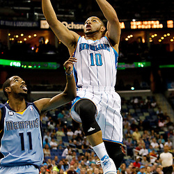 April 15, 2012; New Orleans, LA, USA; New Orleans Hornets shooting guard Eric Gordon (10) shoots over Memphis Grizzlies point guard Mike Conley (11) during the first quarter of a game at the New Orleans Arena.   Mandatory Credit: Derick E. Hingle-US PRESSWIRE