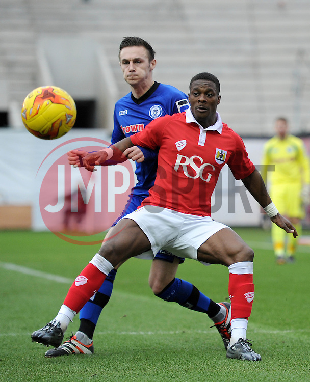 Bristol City's Kieran Agard looks to receive the ball under pressure from Rochdale's Michael Rose - Photo mandatory by-line: Dougie Allward/JMP - Mobile: 07966 386802 - 28/02/2015 - SPORT - football - Bristol - Ashton Gate - Bristol City v Rochdale AFC - Sky Bet League One