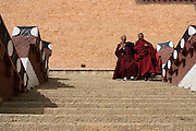 17 February 2007 - Shangarila, Yunnan -  During Chinese New Year celebrations in the Tibetan monastery of Songzhalin, a group of monks run through the temple complex praying at each monastery hall. Photo credit: Luke Duggleby