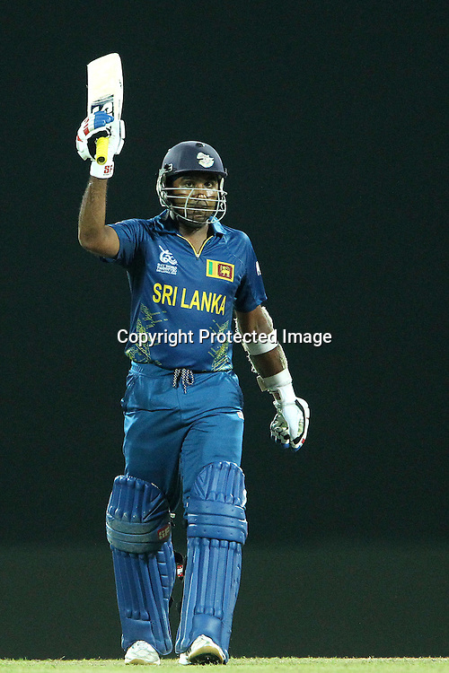 Mahela Jayawardene celebrates his fifty during the ICC World Twenty20 Super 8s match between Sri Lanka and The West Indies held at the  Pallekele Stadium in Kandy, Sri Lanka on the 29th September 2012<br /> <br /> Photo by Ron Gaunt/SPORTZPICS