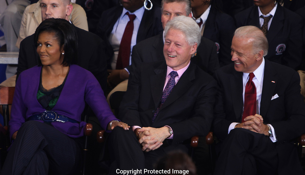Michelle Obama, former president Bill Clinton and Vice President Biden at the signing of the Edward M.Kennedy Serve America Act at the SEED School in Washington, DC on April 21, 2009.  Photo by Dennis Brack