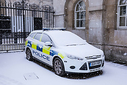 © Licensed to London News Pictures. 27/02/2018. London, UK. A police car covered in snow on Whitehall in central London. Severe cold, blizzards and heavy snow are expected for the rest of the week as the 'Beast from the East' brings freezing Siberian air to the UK. Photo credit: Rob Pinney/LNP