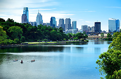 "The Schuykill river meandering trough Fairmount Park with the center city Philadelphia skyline on the background...Fairmount park is one of the world largest innercity green areas..The rowers belong to ""Boat House Row"", just on the right behind the bend of the river."