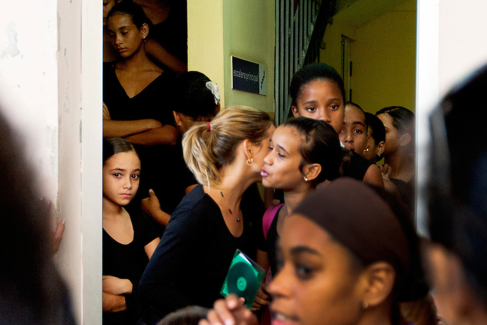 Young girls leave a dance audition in Old havana, Cuba.<br /> You don't have to go looking for dance in Havana. Dance can be found in the crowded , ballet theaters, carnivals, street festivals, Santeria rituals, family celebrations and house parties.