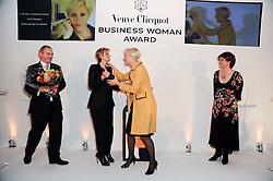 Left to right, GRAHAM BOYES, SABINA BELLI, LAURA TENISON and KATE SILVERTON at the presentation of the Veuve Clicquot Business Woman Award 2010 held at the Institute of Contemporary Arts, 12 Carlton House Terrace, London on 23rd March 2010.  The winner was Laura Tenison - Founder and Managing Director of JoJo Maman Bebe.