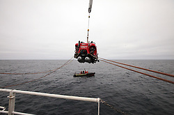USA ALASKA BERING SEA 18JUL12 -  Kirk Sato of the USA, biologist from the Scripps Institution of Oceanography and John Hocevar  from Greenpeace US get ready to dive in a two-seater submersible craft on loan from the Waitt Institute.....The Greenpeace ship Esperanza is on an Arctic expedition to study unexplored ocean habitats threatened by offshore oil drilling, as well as industrial fishing fleets.....Photo by Jiri Rezac / Greenpeace....© Jiri Rezac / Greenpeace