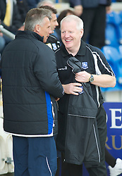 COLCHESTER, ENGLAND - Saturday, September 25, 2010: Tranmere Rovers' Manager Les Parry and Colchester United's Manager John Ward share a joke before the League One match at the Colchester Community Stadium. (Photo by Gareth Davies/Propaganda)
