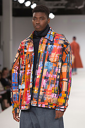 © Licensed to London News Pictures. 31/05/2015. London, UK. Collection by Nicole Whitmer-Bramble. Fashion show of UCA Epsom at Graduate Fashion Week 2015. Graduate Fashion Week takes place from 30 May to 2 June 2015 at the Old Truman Brewery, Brick Lane. Photo credit : Bettina Strenske/LNP