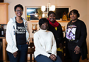 Marilyn Ruffin, Dawn Crim, Qiana Holmes Abanukam, and Teresita Torrence pose for a portrait after their book club meeting in Sun Prairie, Wisconsin, Friday, Oct. 26, 2018.