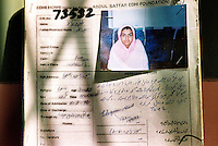 Pakistan, Karachi, 2004. Every day the Edhi Foundation takes in people with nowhere else to turn. This young girl's record is a reminder that society still cares.