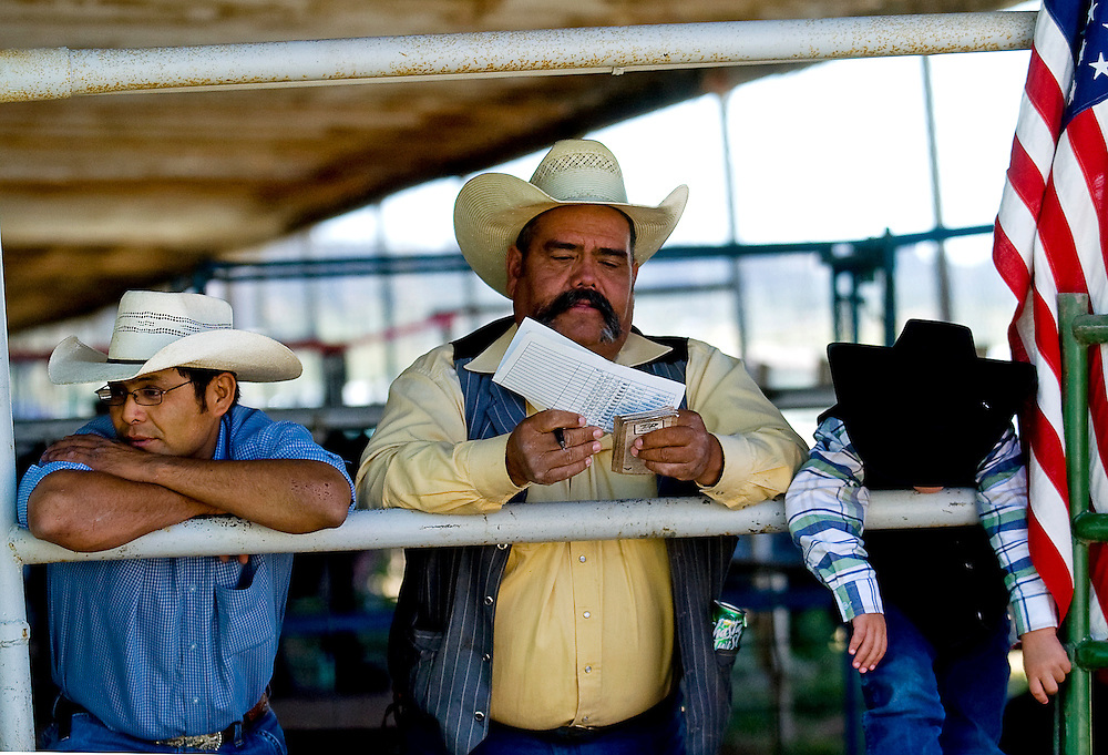 090508      Brian Leddy.Lonnie Duboise (left), Ronnie Vega and Ryan Vega hang out while watching the Navajo Nation 4H Fair Auction on Friday. Vega, who is from Fort Defiance, came to purchase animals on behalf of his business Rio Grand Special Horse and Tack Sales.