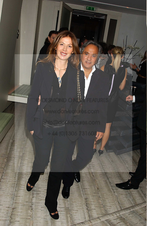 Artist ANISH KAPOOR and his wife SUSANNAH at a dinner hosted by Arnaud Bamber MD of Cartier, Amanda Sharp and Matthew Slotover Directors of the Frieze Art Fair to celebrate artists featured in the 2005 Frieze Art Fair Curatorial Programme at Nobu-Berkeley, 15th Berkeley Street, London on 21st October 2005.<br />