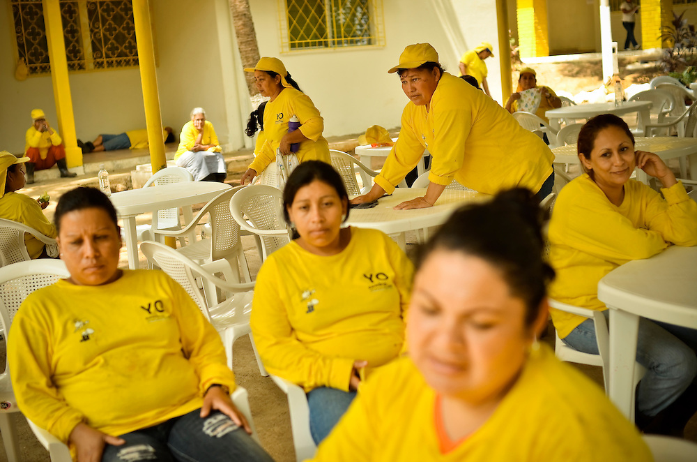 Female inmates rest in a community pavilion between work shifts at the Granja for women in El Salvador. The Granja, a newly launched project, is a working farm that teaches female inmates agriculture skills. In exchange for their work, inmates enjoy better living conditions and more personal freedoms than they had previously at Illopango prison in San Salvador, El Salvador.