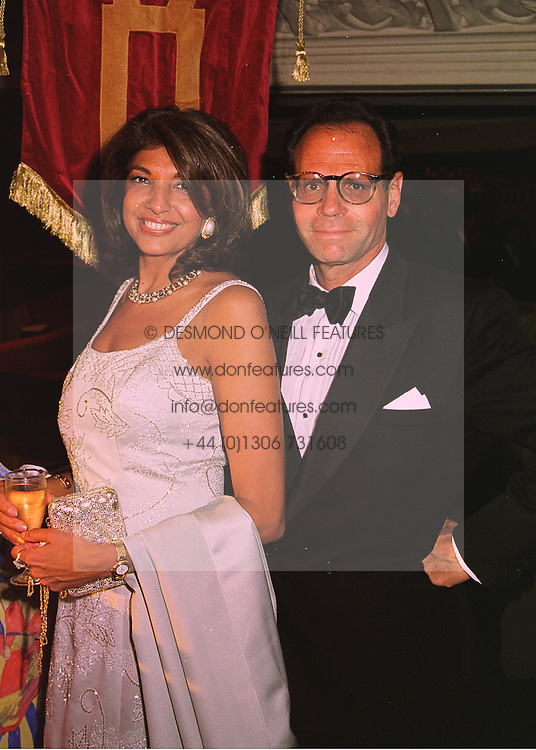 MRS VIMLA LALVANI and MR ROGER WHITE, at a ball in London on 14th May 1998.MHN 4