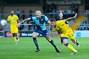 Max Muller (21) of Wycombe Wanderers and Cody McDonald (10) of AFC Wimbledon battle for the ball during the Pre-Season Friendly match between Wycombe Wanderers and AFC Wimbledon at Adams Park, High Wycombe, England on 25 July 2017. Photo by Graham Hunt.