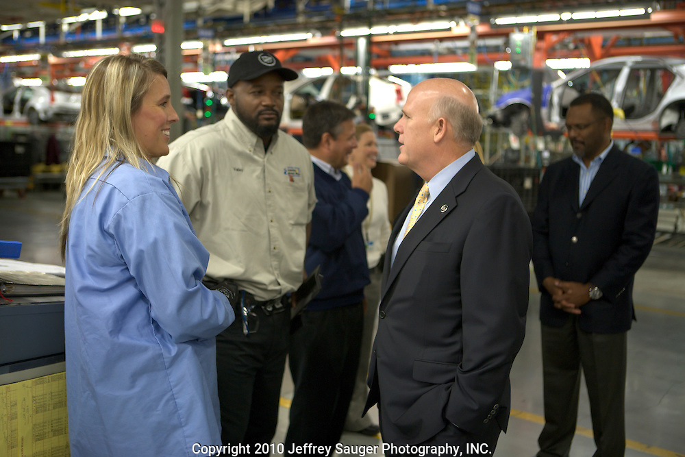 Dan Akerson speaks with Dawn Karn, left, and Demetrius Valley, center, at the General Motors Lansing Grand River plant where GM announced a $190 million investment in the plant to produce an all-new Cadillac small luxury car Thursday, October 28, 2010 in Lansing, Michigan. The investment will create 600 jobs and result in the addition of a second shift. The announcement brings the total of new U.S. investment to over $3.1 billion and more than 7,900 jobs that GM has created or retained in 21 U.S. plants since emerging from bankruptcy in July 2009. (Jeffrey Sauger)