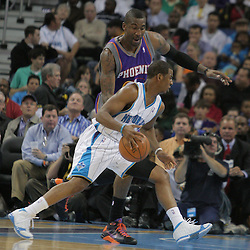 03 December 2008: New Orleans Hornets guard Chris Paul (3) drives against Phoenix Suns forward Amare Stoudemire (1) during a 104-91 victory by the New Orleans Hornets over the Phoenix Suns at the New Orleans Arena in New Orleans, LA..