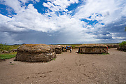 Exterior of straw huts in a Masai Village. Maasai an ethnic group of semi-nomadic people. Photographed in Serengeti, Tanzania