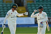 Batsmen Josh Tongue of Worcestershire and Ed Barnard of Worcestershire touch gloves as the walk off the field at the end of the first days play during the Specsavers County Champ Div 1 match between Somerset County Cricket Club and Worcestershire County Cricket Club at the Cooper Associates County Ground, Taunton, United Kingdom on 20 April 2018. Picture by Graham Hunt.