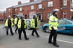 © Licensed to London News Pictures . 18/05/2019. Oldham, UK. Riot police . Former EDL leader Stephen Yaxley-Lennon (aka Tommy Robinson ) continues his campaign for a seat in the European Parliament representing the North West of England , by visiting Oldham . Photo credit: Joel Goodman/LNP
