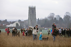 © Licensed to London News Pictures. 06/01/2016. Haxey UK. Picture shows villagers gathering in the field above Haxey for The Haxey Hood that takes place today, The historic event dating back to the 14th century sees teams representing four pubs in Haxey & Westwoodside compete for a leather cylinder known as the hood. After a pub crawl around the participating pubs, the game begins with a famous speech from the ceremonial fool. The game is won when the scrum reaches one of the pubs and the hood is touched by the landlord or landlady. Photo credit: Andrew McCaren/LNP