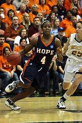 19 March 2010: Philana Greene in control with Caroline Bernal-Silva in tow. The Flying Dutch of Hope College defeat the Yellowjackets of the University of Rochester in the semi-final round of the Division 3 Women's Basketball Championship by a score of 86-75 at the Shirk Center at Illinois Wesleyan in Bloomington Illinois.