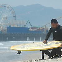 A surfer at Santa monica Beach.